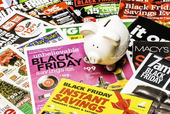 Piggy Bank sitting on Black Friday Ads