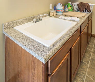 LAUNDRY SINK AND KOHLER FAUCET