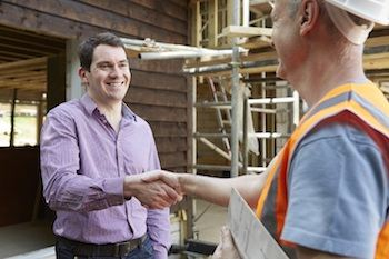 builder shaking hands with owner