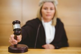 woman judge using gavel at her desk