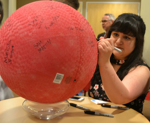 2017 Delaware County Mentee of the Year Sally Miller autographs a ball during Project Leadership's annual Red Rubber Ball celebration