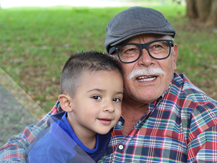 Grandpa and grandson in park